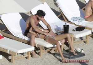 nabilla benattia boobs flashing on vacation 005